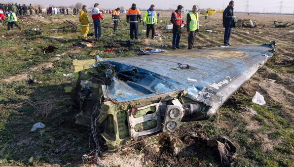"""A handout photo provided by the Iranian news agency IRNA on January 8, 2020, shows rescue teams working at the scene of a Ukrainian airliner that crashed shortly after take-off near Imam Khomeini airport in the Iranian capital Tehran. Search-and-rescue teams were combing through the smoking wreckage of the Boeing 737 flight from Tehran to Kiev but officials said there was no hope of finding anyone alive. The vast majority of the passengers on the Ukraine International Airlines flight were non-Ukrainians, including 82 Iranians and 63 Canadians, officials said. - RESTRICTED TO EDITORIAL USE - MANDATORY CREDIT """"AFP PHOTO/IRNA/AKBAR TAVAKOLI"""" - NO MARKETING NO ADVERTISING CAMPAIGNS - DISTRIBUTED AS A SERVICE TO CLIENTS ---  / AFP / IRNA / IRNA / Akbar TAVAKOLI / RESTRICTED TO EDITORIAL USE - MANDATORY CREDIT """"AFP PHOTO/IRNA/AKBAR TAVAKOLI"""" - NO MARKETING NO ADVERTISING CAMPAIGNS - DISTRIBUTED AS A SERVICE TO CLIENTS ---"""