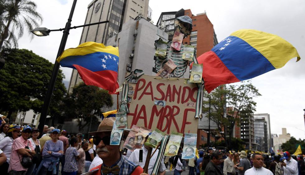 Juan Guaidó encabeza en Venezuela una marcha para reavivar la presión contra el régimen de Nicolás Maduro, con el respaldo de varios países encabezados por Estados Unidos. (AFP).