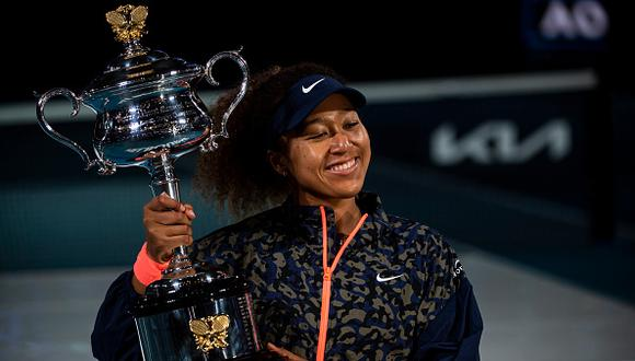 MELBOURNE, AUSTRALIA - FEBRUARY 20: Naomi Osaka of Japan celebrates with the Trophy after defeating Jennifer Brady of the United States in the women's singles final, during day 13 of the 2021 Australian Open at Melbourne Park on February 20, 2021 in Melbourne, Australia. (Photo by TPN/Getty Images)