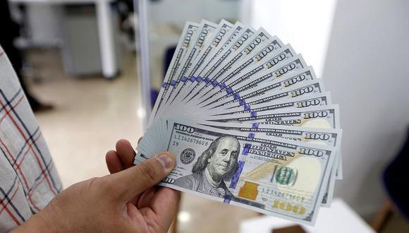 En el mercado paralelo o casas de cambio de Lima, el tipo de cambio se cotizaba a S/ 3.700 la compra y S/ 3.730 la venta. (Foto: AFP)