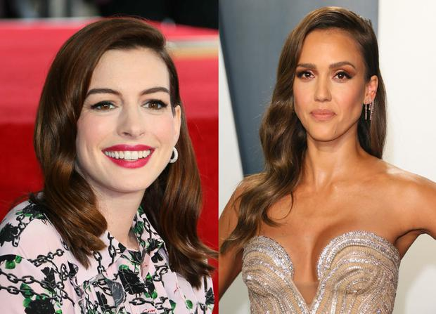 Anne Hathaway and Jessica Alba.  (Photo by JEAN-BAPTISTE LACROIX / AFP)