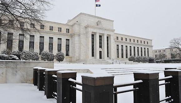 Fed continúa retirada progresiva de la multimillonaria inyección de liquidez. (AFP)