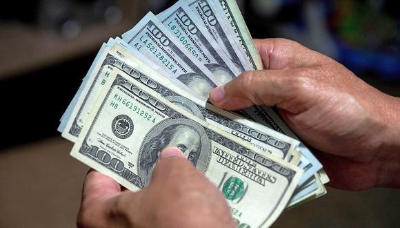 El precio del dólar se negociaba en 3'174.544,00 bolívares soberanos en Venezuela. (Foto referencial: AFP)