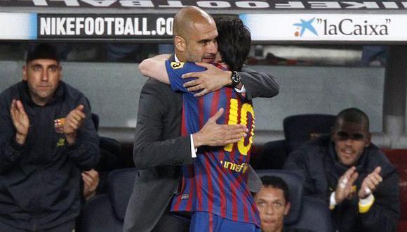 Messi se abraza con Guardiola tras marcar su cuarto gol en el 4-0 ante el Espanyol. (Reuters)