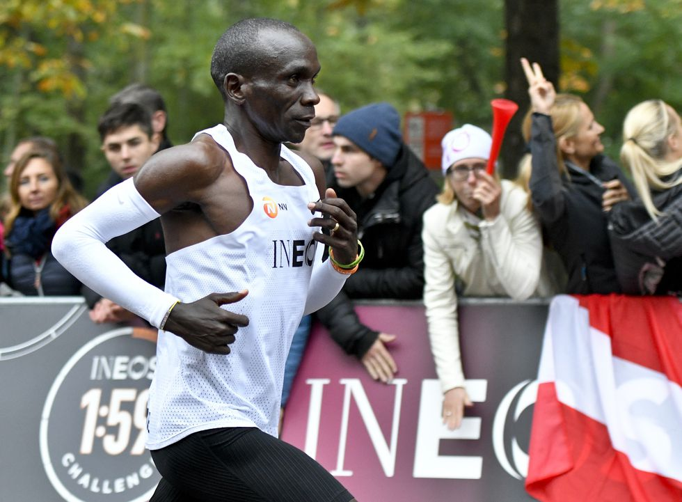 Kenya's Eliud Kipchoge (white jersey) runs during his attempt to bust the mythical two-hour barrier for the marathon on October 12 2019 in Vienna. - Kipchoge holds the men's world record for the distance with a time of 2hr 01min 39sec, which he set in the flat Berlin marathon on September 16, 2018. He tried in May 2017 to break the two-hour barrier, running on the Monza National Autodrome racing circuit in Italy, failing narrowly in 2hr 00min 25sec. (Photo by HERBERT NEUBAUER / APA / AFP) / Austria OUT