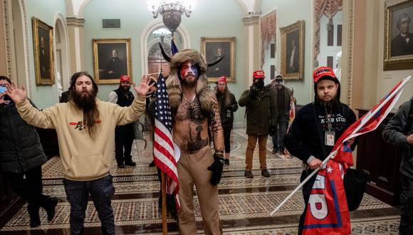 El Departamento de Justicia de Estados Unidos informó que ya ha acusado formalmente a más de 70 personas. (Foto: SAUL LOEB / AFP)
