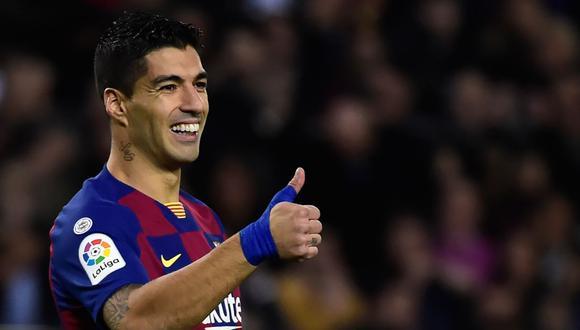 Suárez se marcha al Atlético de Madrid como tercer máximo goleador de la historia del Barcelona (198 tantos) y tras levantar trece títulos en seis temporadas. (Foto: AFP)